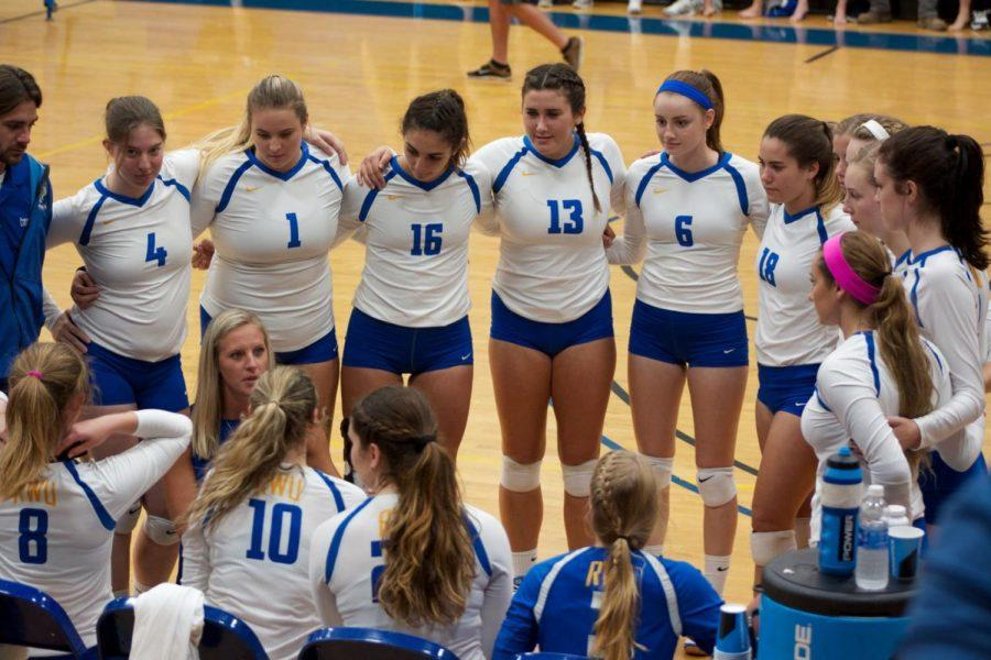 Roger Williams University women's volleyball head coach Danielle Soubliere instructs her team in the huddle during a match against Salve Regina University.