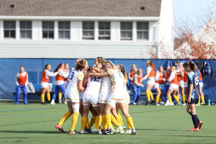 The Roger Williams University women's soccer team embraces each other on the field as they clinched their third CCC title in the last four years with a 1-0 victory over Gordon College on Nov. 4.