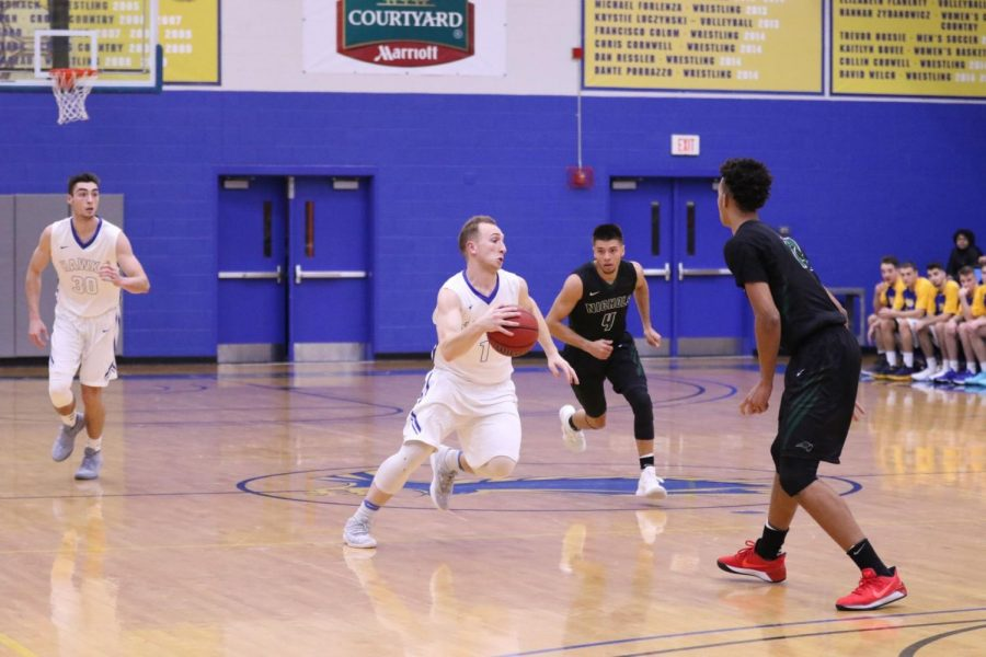 The Roger Williams University Hawks men's basketball team suffered their ninth consecutive loss to the Nichols College Bison in a 91-79 verdict on Tuesday, Dec. 5.