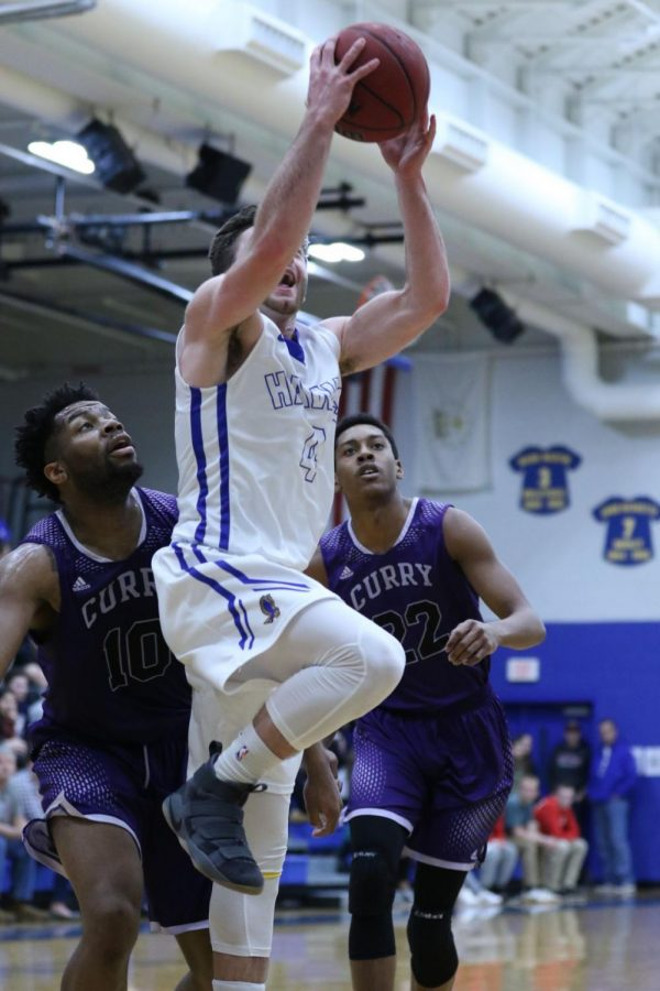 Hawks junior guard Jake Heaton drives to the rim against Curry College on Saturday, Feb. 10. The Hawks defeated the Colonels 96-76.