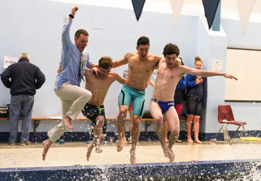 From left to right: Coach Emmert, senior Andrew Gillie, senior Paul Marchese, and senior Connor Lautenschlager jump in after the win.
