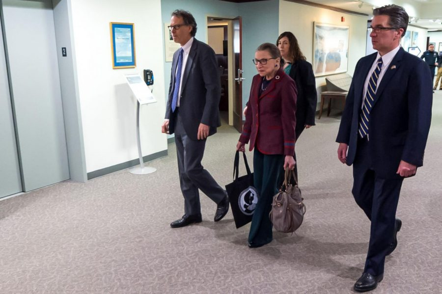 Justice Ginsburg on the move, flanked by her security detail.