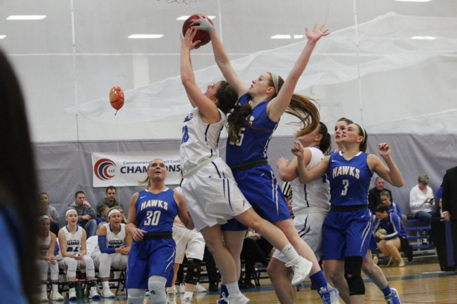 Senior Teagan Dunn blocks a shot on defense against UNE on Feb. 24 during the CCC championship game.