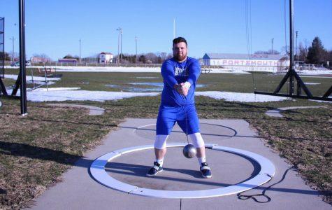 Junior Sam Lugo practices his hammer throw.