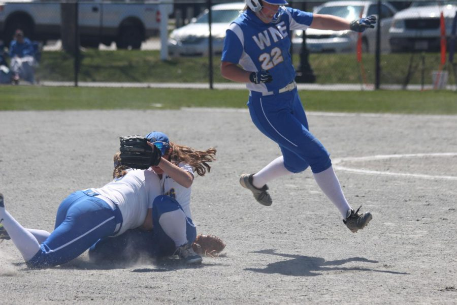 Senior Haley Ledbetter (left) and sophomore Taylor Chatowsky (right) collide trying to field a ball during a doubleheader Sunday vs. WNE.