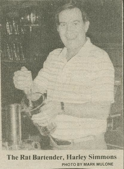 The Rat bartender at the time, Harley Simmons, likely filling a pitcher of beer for students.