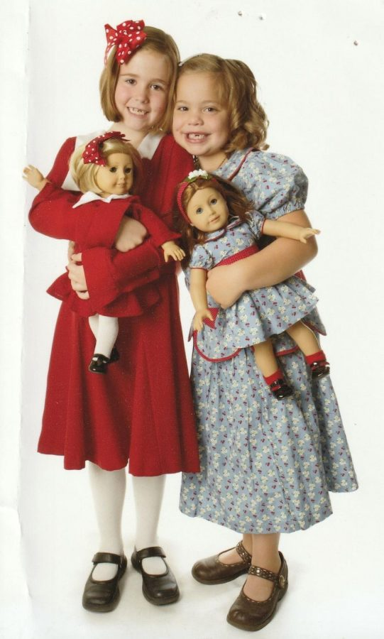 Sofie Andrews (right) holding an Emily Bennett doll while modeling for the role of Emily. She poses with Caroline, a young girl who modeled for Kit Kittredge, who is on the left.