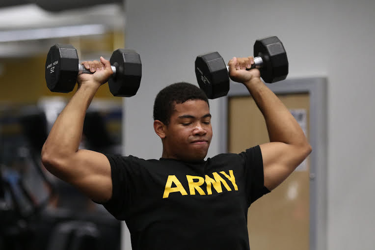 Hayes hits the gym with ROTC during one of their weekly 6 a.m. lifts.
