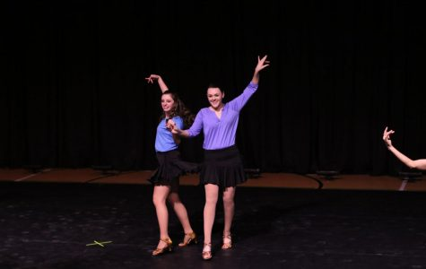 Abby Camire (left) and Emily Kiehl (right) dance in