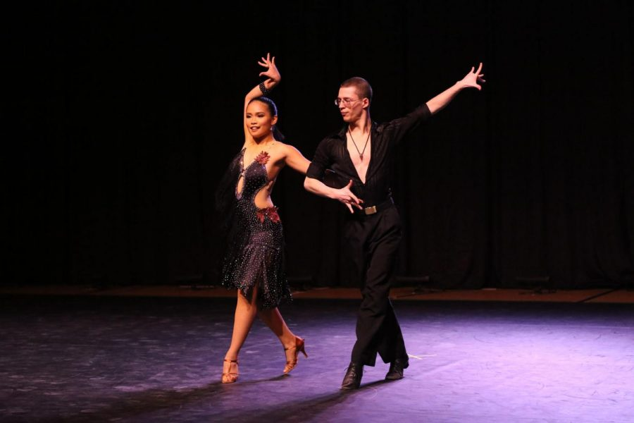 Sophia Sabaten, vice president of the Ballroom Dance Club, and Ben Toth dance to