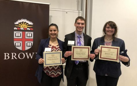 (From left to right) Tatevik Khachatryan, Nicholas Polinsky and Michaela Aptt pose with their awards at the Brown University Crisis Simulation.