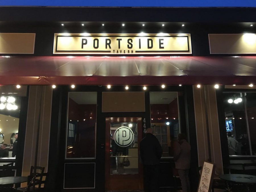 Portside Tavern storefront lit up at night