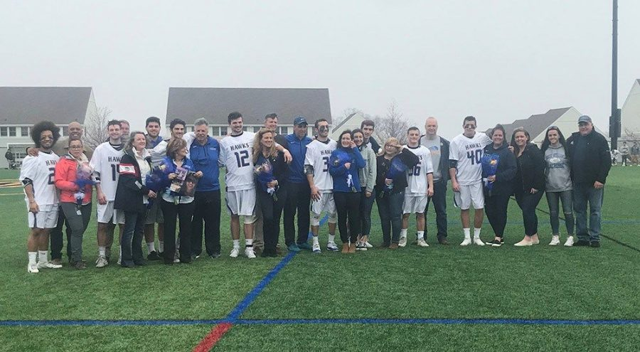 Seniors+Isaiah+Washington%2C+Campbell+Gillis%2C+Chris+Bova%2C+Weston+Nolan%2C+Danny+Reale%2C+Joseph+Elia+and+Shawn+Errasti+line+up+for+a+photo+with+their+families+at+their+senior+game.