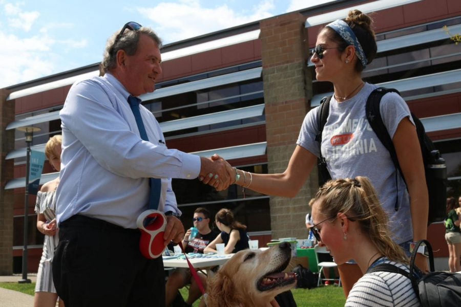 Students+talk+to+President+Miaoulis+and+pet+his+golden+retriever+Fletcher+at+the+Sept.+4+Involvement+Fair.