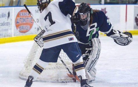 Hannah Palmer shooting on goal in an Ice hockey Game.