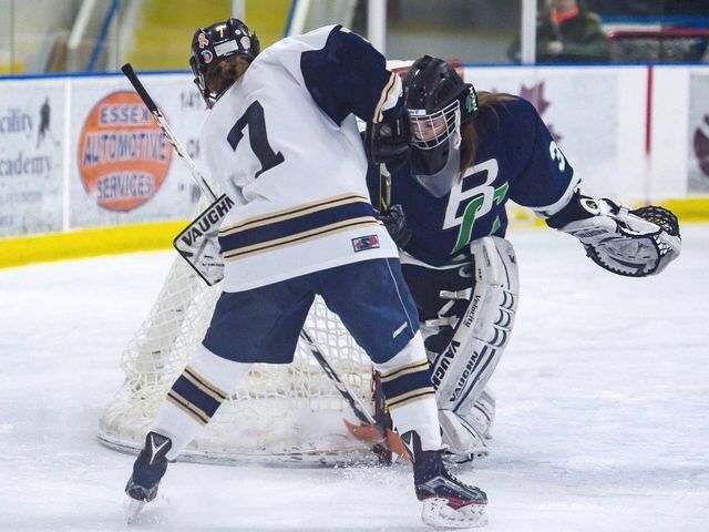 Hannah Palmer shooting on goal in an Ice hockey Game.