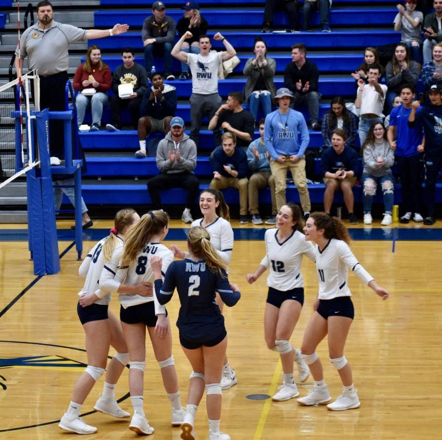Volleyball+scores+and+comes+together+to+celebrate+during+a+game.