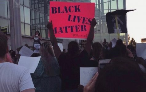 A person holds up a sign at a Black Lives Matter rally in Providence, R.I. 2016