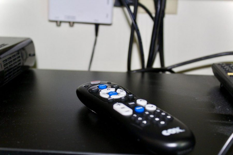 Students can get a remote from Media Tech to access cable in the dorms.