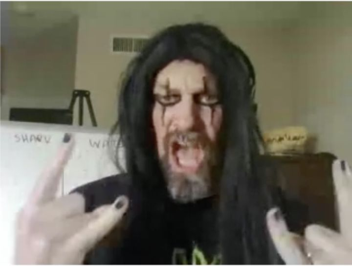 Dr. Webb dresses up in the style of a KISS band member. He dresses up in different costumes for each online class.