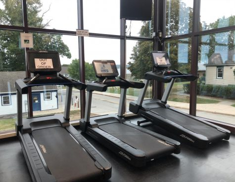 Students cannot use cardio machines directly next to each other in RWU's Fitness Center. Certain machines are blocked off to maintain appropriate distance between gym-goers.