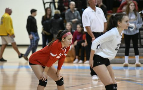 RWU freshman Rachel Borzone played volleyball throughout her life, pictured above in a match she competed in with her high school.