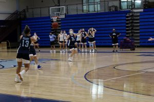 Women's Basketball Coach Kelly Thompson oversees practice with the team on Oct. 17, 2020.