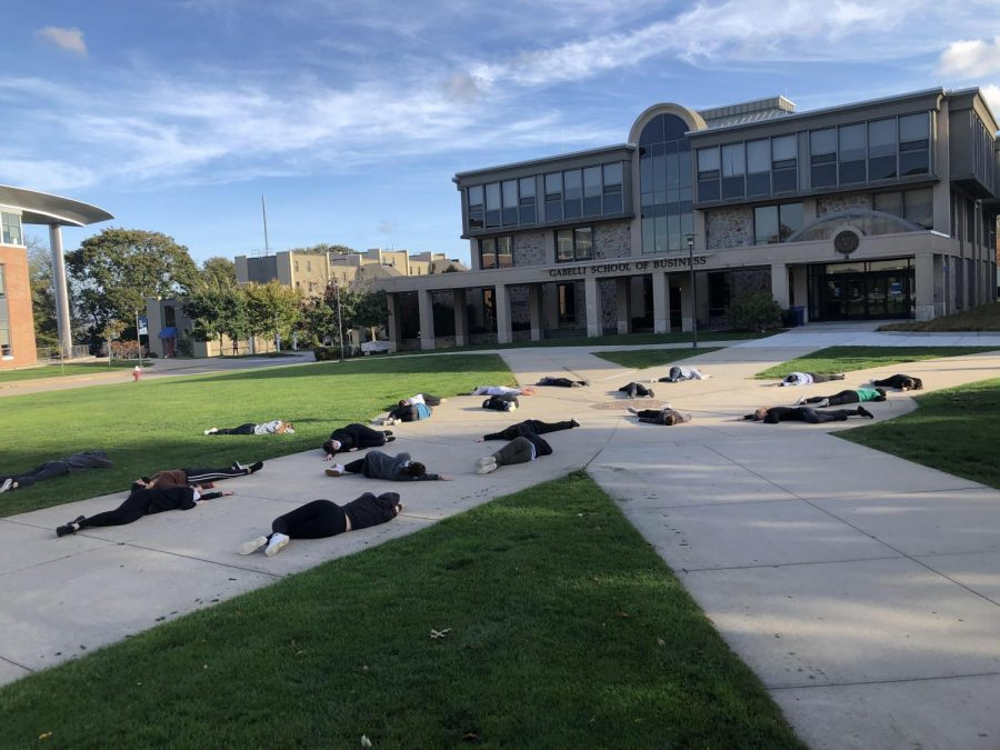 RWU Dance & Performance Studies students in fallen positions for the start of the event.