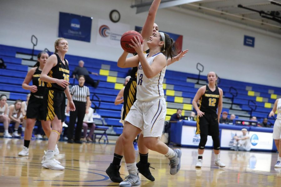 Alyssa+Grant+going+in+for+a+lay-up+in+a+game+on+Jan.+3%2C+2019+against+Wentworth+before+her+injury.