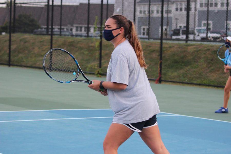 Senior Captain Heidi Martin working on her technique in tennis practice.