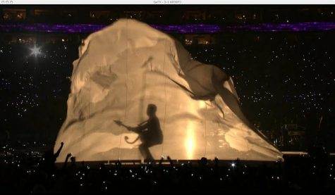 giant sheet shoots up and reveals a thirty-foot shadow of Prince during the 2007 Super Bowl halftime show.