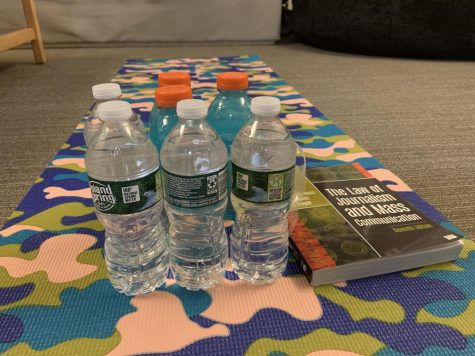 Get creative using alternative weights like water bottles and textbooks for workouts in your residence hall room.