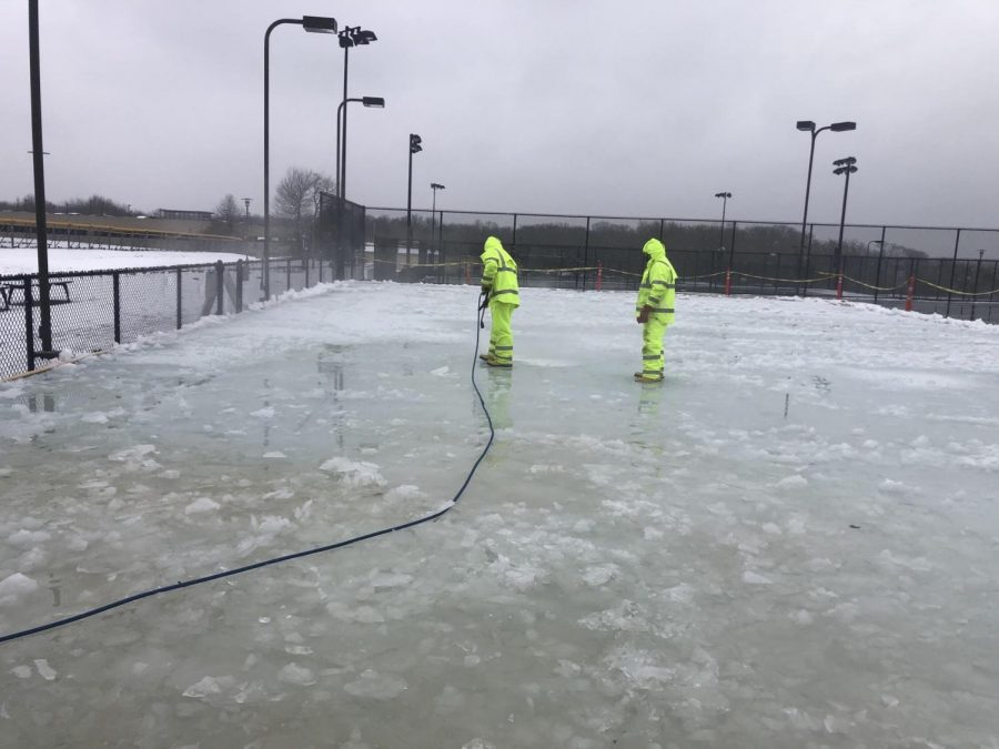 The+campus+ice+rink+was+set+to+open+on+Jan.+27%2C+but+snow+from+a+mild+storm+created+too+much+slush+and+prevented+the+opening+from+happening.+Members+of+Facilities%2C+pictured+here%2C+tried+using+a+heated+pressure+washer+to+smooth+the+ice+but+it+did+not+work+out.