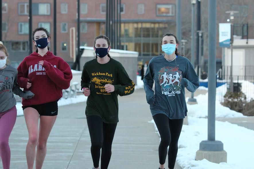 Members of the womens track and field team prepare for the 2021 spring season.
