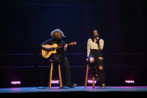 Thomas Wallace played the guitar and Gabriella Robertiello sang for their performance during the Roger