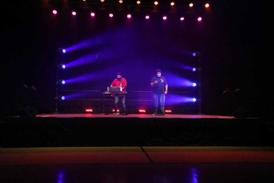 Adam Zerman played the piano and guitar while Joe Brown sang during their performance at the Roger's Miracle Network Talent Show.