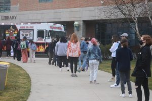 Students waited for their free potato from The Hot Potato food truck.
