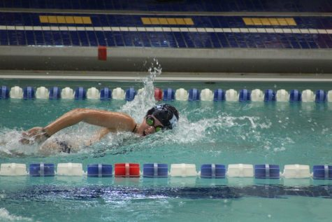 Emily is pictured competing in the sprint event at a swim meet.