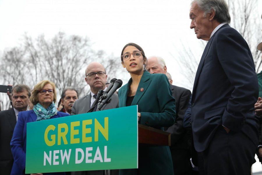 New York Representative Alexandria Ocasio-Cortez (center) and Massachusetts Senator Ed Markey (right) propose the Green New Deal in February 2019.