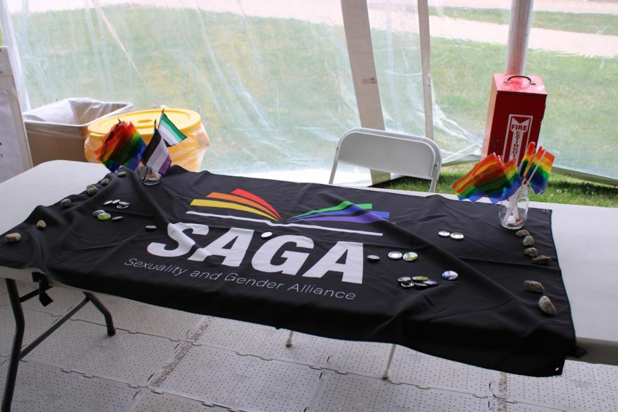 Decorated tables lined the Commons Tent with queer and trans information and resources.