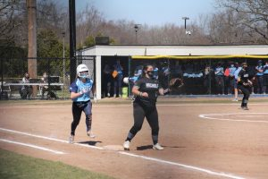 Sophomore Emma MacLean sprints her way to first base in a game against Nichols on March 27, 2021. The final score was 11-1 giving Roger Williams University another win.