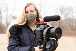 Megan is captured here with her camera equipment after she had just finished an on camera interview for her journalism capstone course.