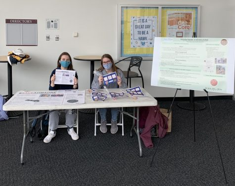 Shannon DeFranza (left) and Hannah Sterling (right) participate in Table Times in the Rec Center on April 15 to spread awareness about imprisoned scholars.