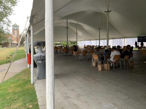 Students dine in the outdoor tent on Sept. 2, 2020. The university plans to bring the tent back to the quad starting April 8 for multipurpose use.