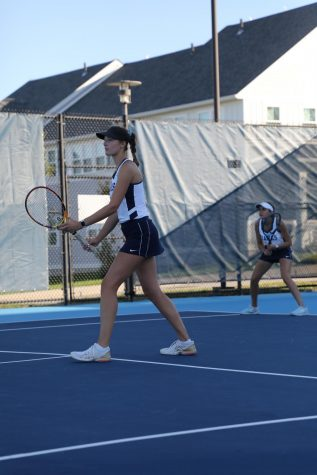 Emma Place and Alessia Cahoon in their doubles match versus Suffolk University at home on Wednesday, Sept. 29. The pair won their match.