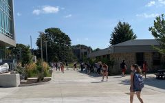 Students walking in between CAS and new SECCM building. Fall semester COVID guidelines say that masks are not required when walking outside.