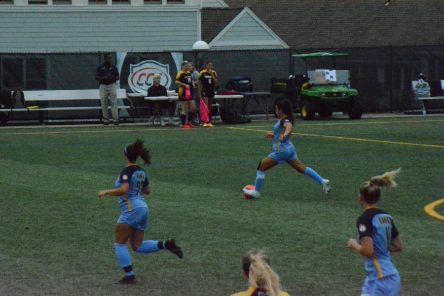 Senior+Sammy+Jost+kicks+the+ball+up+the+field+during+the+Womens+Soccer+home+game+against+Framingham+State+on+September+1.+Josts+focus+and+dedication+during+the+game+shows+her+true+talent+and+passion+for+soccer.