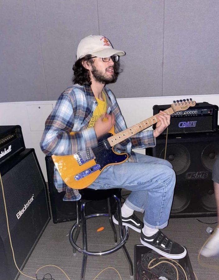 Musician Nathan Watlington playing electric guitar.