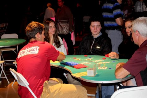 Students and their families enjoy Casino Night during Homecoming and Family Weekend in 2017.